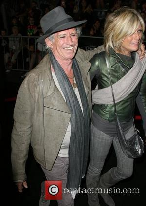 Keith Richards and model Patti Hansen Pirates Of The Caribbean: On Stranger Tides World Premiere held at Disneyland Anaheim, California...