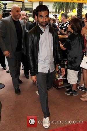Aziz Ansari serves pizza at The Lincoln Road Pizza Rustica to promote his new film '30 Minutes or Less'...