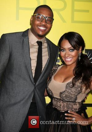 Carmelo Anthony and LaLa Vasque BET networks chairman Debra L. Lee hosts 5th annual pre-BET awards celebration dinner at Book...