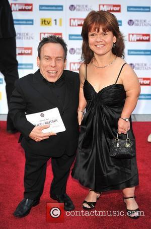 Warwick Davis and guest 2011 Pride of Britain Awards held at the Grosvenor House - Arrivals. London, England - 03.10.11