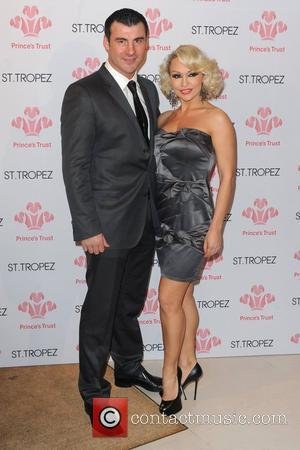 Joe Calzaghe and Kristina Rihanoff, wearing a ring on her engagement finger Prince's Trust Spring Ball at The Hurlingham Club...