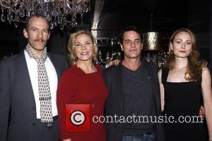 Kim Cattrall and Paul Gross