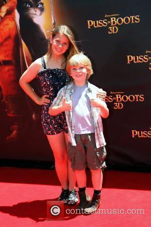 Bindi Irwin and Bob Irwin The premiere of 'Puss In Boots 3D' held at the Entertainment Quarter Sydney, Australia -...