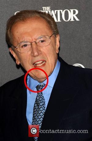 Sir David Frost seems to be partly unshaven and left some part of his beard on his neck Quintessentially Awards...