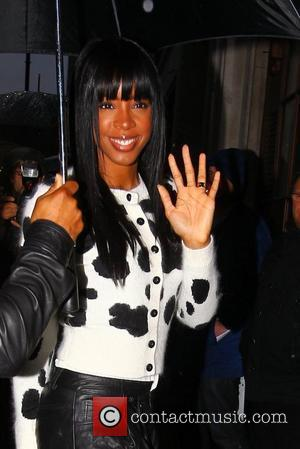 'X Factor' judge Kelly Rowland arriving at the BBC Radio 1 studios in the rain London, England - 04.11.11