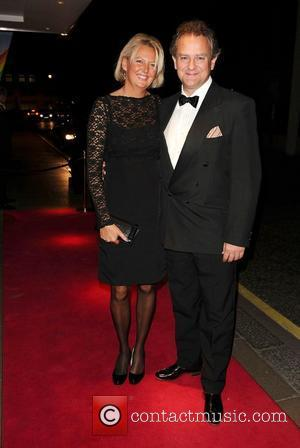 Hugh Bonneville and wife Lulu Evans arrives at the Rainbow Trust's Silver Jubilee Ball, The Savoy Hotel. London, England -...