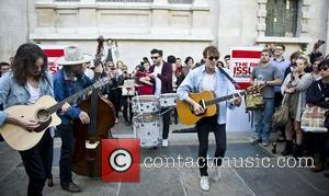 Gus Robertson, Freddie Stitz, David 'Skully' Sullivan Kaplan and Johnny Borrell  Razorlight performing a 'Big Busk' Event at St...