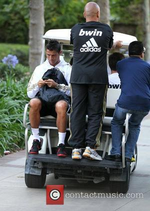 Real Madrid forward Cristiano Ronaldo leaves a training session with the rest of his team mates ahead of their match...