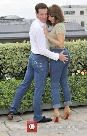Anton du Beke & Carol Vorderman Winner of the Male & Female Wizzard Jeans Rear of the Year 2011. held...