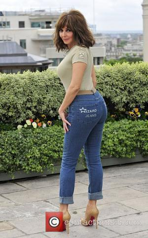 Carol Vorderman Winner of the Female Wizzard Jeans Rear of the Year 2011. held at the Dorchester Hotel London, England...