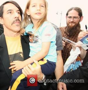 Anthony Kiedis of the Red Hot Chili Peppers arriving at the Canal+ studio with his son Everly Bear Paris, France...