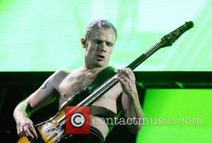 Michael Balzary aka Flea of the Red Hot Chilli Peppers  performing at the LG Arena Birmingham, England - 20.11.11