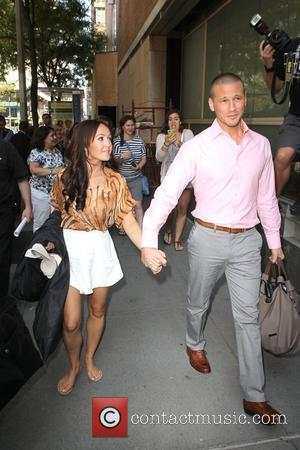 Bachelorette Ashley Herbert and her fiancee J.P. Rosenbaum arrive at ABC Studios for their appearance on 'Live with Regis and...