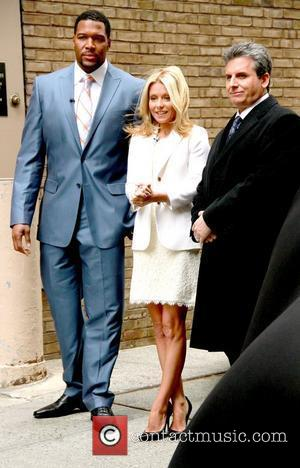 Alan Taylor, Kelly Ripa, and Michael Strahan at ABC's 'Live with Regis & Kelly' previewing cars from the New York...