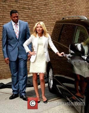 Michael Strahan and Kelly Ripa at ABC's 'Live with Regis & Kelly' previewing cars from the New York Auto Show...