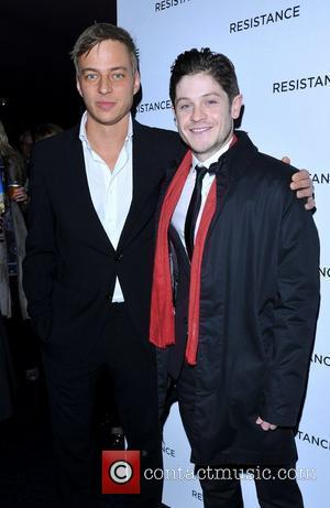 Iwan Rheon and guest Resistance - UK film premiere held at the Curzon Mayfair - Arrivals. London, England - 20.11.11