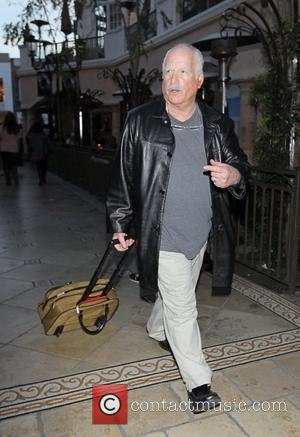 Richard Dreyfuss pulling a small luggage case walking through The Grove Los Angeles, California - 05.03.11