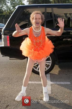 Richard Simmons seen arriving for one of his evening classes wearing a neon orange tutu and workout attire Los Angeles,...