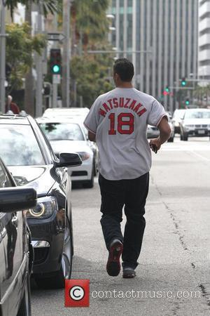 Rick Fox  running to his car in Beverly Hills  Los Angeles, California - 15.03.11