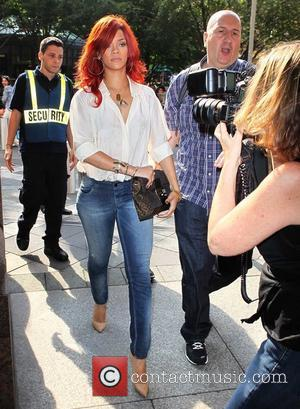 Rihanna carrying a large clutch as she arrives for a photo shoot with a bodyguard New York City, USA -...