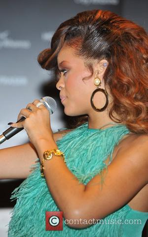 Rihanna promotes her new fragrance Reb'l Fleur at the 'House of Fraser' store in central London London, England - 19.08.11
