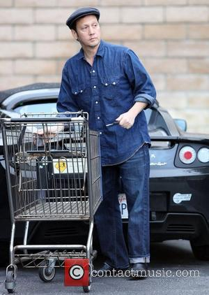 Rob Schneider fills up his car with groceries after shopping at Whole Foods Studio City, California - 11.11.11