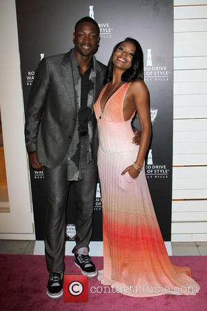 Dwyane Wade and Gabrielle Union The Rodeo Drive Walk of Style honoring Iman and Missoni held at Rodeo drive...
