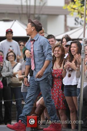 Romeo and Chelsie Hightower film an interview segment for 'Extra' with Mario Lopez at The Grove in Hollywood Los Angeles,...