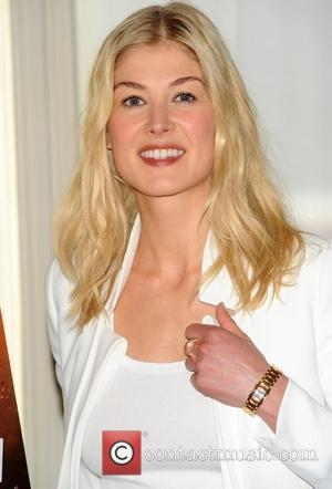 Rosamund Pike at a photocall for the release of 'Johnny English Reborn' at The Mandarin Oriental London, England - 12.09.11