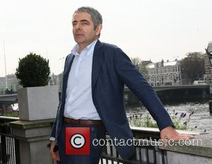 Rowan Atkinson poses for photographers during his promotional tour for 'Johnny English Reborn' at the Amstel Hotel Amsterdam, Holland -...