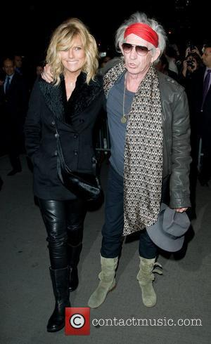 Patti Hansen and Keith Richards Playboy hosts the New York premiere of 'The Rum Diary' at the Museum of Modern...