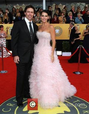 Jason Sehorn and Angie Harmon