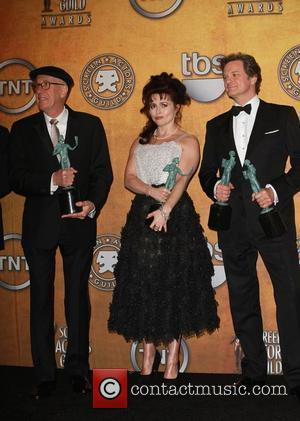 Geoffrey Rush, Helena Bonham Carter and Colin Firth The 17th Annual Screen Actors Guild Awards (SAG Awards 2011) held at...