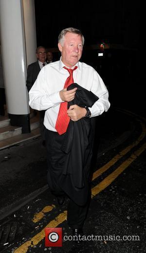 Sir Alex Ferguson leaving San Carlo Restaurant Manchester, England - 08.09.11