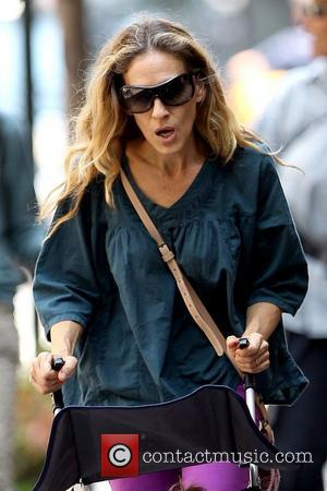 Sarah Jessica Parker  pushing one of her twin daughters in stroller in Soho New York City, USA - 02.08.11