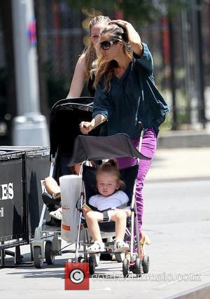 Sarah Jessica Parker and Marion Broderick Sarah Jessica Parker and a nanny pushing her twin daughters in strollers in Soho...
