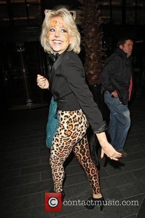 Pixie Lott arriving at the Savoy Hotel in a leopard patterned catsuit London, England - 01.11.11