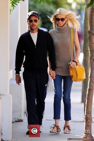 Claudia Schiffer and her husband Matthew Vaughn hold hands after dropping their children at school London, England - 01.07.11