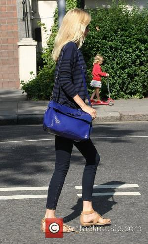 Claudia Schiffer  walking in London after dropping her children off at school London, England - 05.07.11
