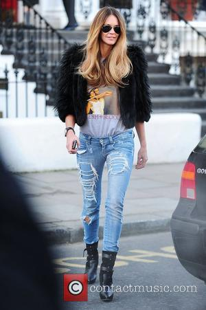 Elle Macpherson  after dropping her children off at school London, England - 08.02.11