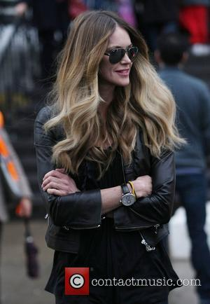 Elle Macpherson after dropping her children off at school London, England - 11.02.11