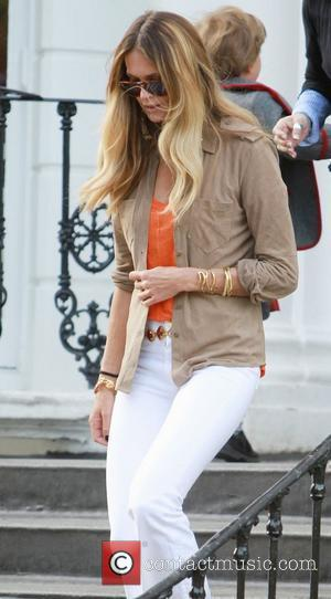 Elle Macpherson  after dropping her children off at school London, England - 24.05.11