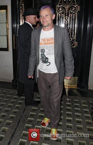 Flea aka Michael Peter Balzary Red Hot Chili Peppers band members leaving Scotts restaurant in Mayfair London, England - 02.09.11