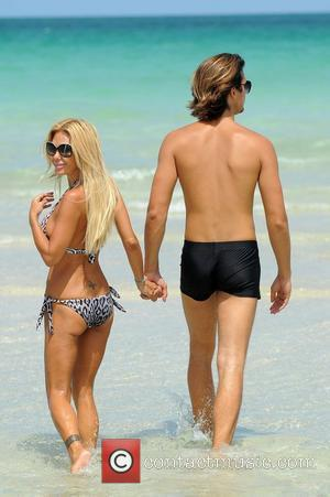 Shauna Sand and current boyfriend Laurent Homburger spending the day together at the beach Miami Beach, Florida - 14.07.11,