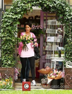 Sheree Murphy leaves a florist with a bunch of flowers ahead of Mother's Day (3.04.11) Liverpool, England - 01.04.11