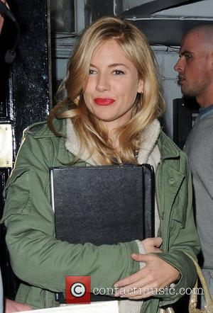 Sienna Miller leaves a theatre where she is rehersing for a new production of Terence Rattigan's play, 'Flare Path' London,...
