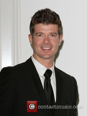 Robin Thicke at the 2011 Silver Rose gala and auction at Beverly Hills Hotel. Beverly Hills, California - 17.04.11