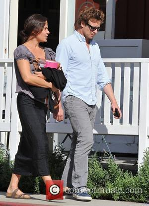 'The Mentalist' actor, Simon Baker and his wife Rebecca Rigg are seen at Brentwood Country Mart. Brentwood, California - 26.01.11