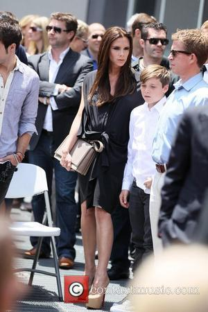 Victoria Beckham and Brooklyn