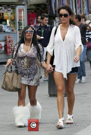 Nicole Polizzi aka Snooki and Jenni Farley aka JWow filming for MTV's 'Jersey Shore'. Jwow comforts Snooki who is upset...